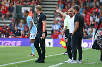 Football - 2017 / 2018 Premier League - AFC Bournemouth vs. Manchester City<br /> <br /> Manchester City Manager Pep Guardiola and Bournemouth's Manager Eddie Howe exchange words on the touch line at the Vitality Stadium (Dean Court) Bournemouth<br /> <br /> COLORSPORT/SHAUN BOGGUST