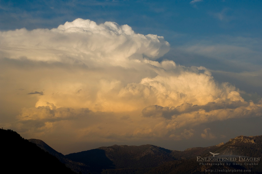Cumulonimbus thunderstorm clouds at sunst above Desolation Wilderness, El Dorado National Forest, California