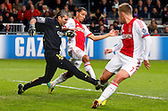Onderwerp/Subject: Ajax - FC Barcelona - Champions League<br /> Reklame:  <br /> Club/Team/Country: <br /> Seizoen/Season: 2013/2014<br /> FOTO/PHOTO: Goalkeeper PINTO ( Jose Manuel Pinto COLORADO ) (L) of FC Barcelona in duel with Ricardo VAN RHIJN (C) of Ajax and Viktor FISCHER (R) of Ajax. (Photo by PICS UNITED)<br /> <br /> Trefwoorden/Keywords: <br /> #04 $94 &plusmn;1377840750319<br /> Photo- &amp; Copyrights &copy; PICS UNITED <br /> P.O. Box 7164 - 5605 BE  EINDHOVEN (THE NETHERLANDS) <br /> Phone +31 (0)40 296 28 00 <br /> Fax +31 (0) 40 248 47 43 <br /> http://www.pics-united.com <br /> e-mail : sales@pics-united.com (If you would like to raise any issues regarding any aspects of products / service of PICS UNITED) or <br /> e-mail : sales@pics-united.com   <br /> <br /> ATTENTIE: <br /> Publicatie ook bij aanbieding door derden is slechts toegestaan na verkregen toestemming van Pics United. <br /> VOLLEDIGE NAAMSVERMELDING IS VERPLICHT! (&copy; PICS UNITED/Naam Fotograaf, zie veld 4 van de bestandsinfo 'credits') <br /> ATTENTION:  <br /> &copy; Pics United. Reproduction/publication of this photo by any parties is only permitted after authorisation is sought and obtained from  PICS UNITED- THE NETHERLANDS