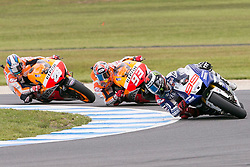 © Licensed to London News Pictures. 20/10/2012. Jorge Lorenzo (SPA) riding for the Yamaha Factory Racing leading Marc Marquez (SPA) riding for the Repsol Honda Team & Dani Pedrosa (SPA) riding for the Repsol Honda Team during the Race day of the round 16 2013 Tissot Australian Moto GP at the  Phillip Island Grand Prix Circuit Victoria, Australia. Photo credit : Asanka Brendon Ratnayake/LNP