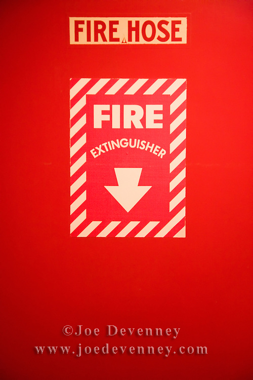 Old fashioned sign for a fire extinguisher