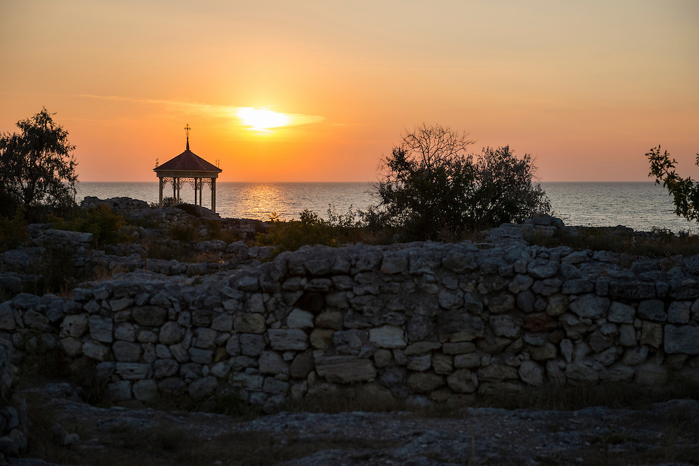 The sun sets at Khersones, an ancient site in Sevastopol, Crimea, in Ukraine. The structure on the left commemorates the baptism of Prince Vladimir here in 988. Vladimir was the leader of Kievan Rus'.