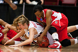 March 19, 2011; Stanford, CA, USA; St. John's Red Storm guard Eugeneia McPherson (right) grabs a loose ball from Texas Tech Lady Raiders forward Jordan Barncastle (bottom) during the second half of the first round of the 2011 NCAA women's basketball tournament at Maples Pavilion. St. John's defeated Texas Tech 55-50.