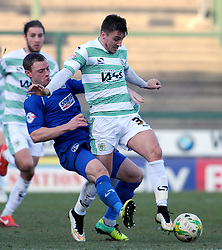 Yeovil Town's Adam Morgan is tackled by Oldham Athletic's Brian Wilson  - Photo mandatory by-line: Harry Trump/JMP - Mobile: 07966 386802 - 07/03/15 - SPORT - Football - Sky Bet League One - Yeovil Town v Oldham Athletic - Huish Park, Yeovil, England.