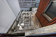 Tokyo, Japan, July 23 2016 - A capsule as seen from above at the Nakagin Capsule Tower, designed by architect Kisho Kurokawa and completed in 1972. The building is a rare example of Metabolism architecture movement.
