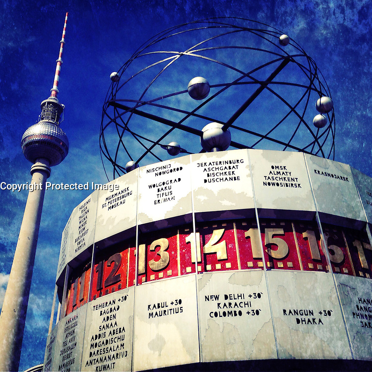World clock and Television Tower at Alexanderplatz in Berlin Germany