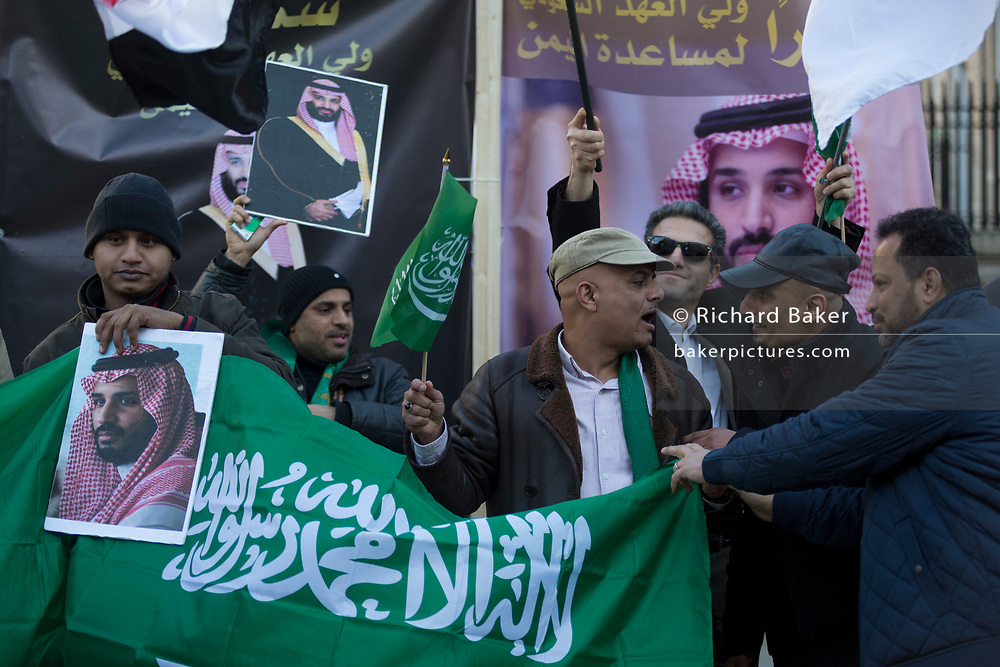 On the first day of his official 3-day visit to London, supporters of Saudi Crown Prince Mohammed bin Salman celebrate in Whitehall before bin Salman's meeting with Prime Minister Theresa May in Downing Street, on 7th March 2018, in London England.