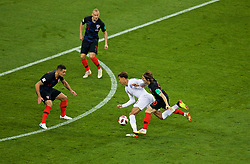 MOSCOW, RUSSIA - Wednesday, July 11, 2018: England's Dele Alli is fouled by Croatia's captain Luka Modrić for a free-kick that England scored the opening goal from during the FIFA World Cup Russia 2018 Semi-Final match between Croatia and England at the Luzhniki Stadium. (Pic by David Rawcliffe/Propaganda)