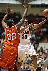 Adrian Joseph (30) shoots over Clemson's Sam Perry (32).  Joseph had a game high 19 points to lead the Cavs to a 64-58 ACC victory.