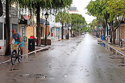 September 9, 2017 - Key West, FL, USA - A lone cyclist rides along deserted Duval Street in Key West, Fla., on Saturday, Sept. 9, 2017. Hurricane Irma is approaching the Florida Keys and some residents refused to be evacuated. (Credit Image: © Charles Trainor Jr/TNS via ZUMA Wire)