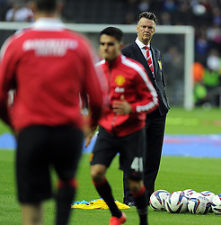 Manchester United Manager, Louis van Gaal watches his players warm up - Photo mandatory by-line: Joe Meredith/JMP - Mobile: 07966 386802 26/08/2014 - SPORT - FOOTBALL - Milton Keynes - Stadium MK - Milton Keynes Dons v Manchester United - Capital One Cup