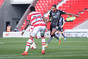 Colchester United forward Kurtis Guthrie (28)  with a shot during the EFL Sky Bet League 2 match between Doncaster Rovers and Colchester United at the Keepmoat Stadium, Doncaster, England on 15 October 2016. Photo by Simon Davies.