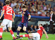 Lionel Messi is challenged during the Group G UEFA Champions League match between FC Barcelona and Spartak Moscow at the Nou Camp, Barcelona, Spain 19th September 2012. Credit - Eoin Mundow/Cleva Media