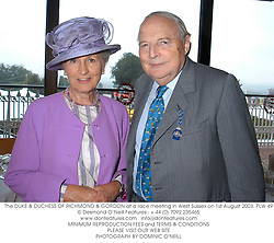 The DUKE & DUCHESS OF RICHMOND & GORDON at a race meeting in West Sussex on 1st August 2003.PLW 49