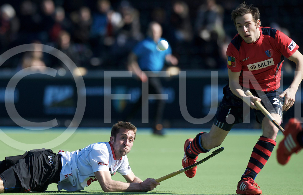 Amstelveen - Euro Hockey league KO16.Amsterdamse H&BC - Berliner HC.foto: Roc Oliva (white) and Max Bädelt (red)..FFU PRESS AGENCY COPYRIGHT FRANK UIJLENBROEK.