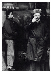 Picture by Mark Larner. Picture shows men smoking on a St. Petersburg street corner. Russia 1993.