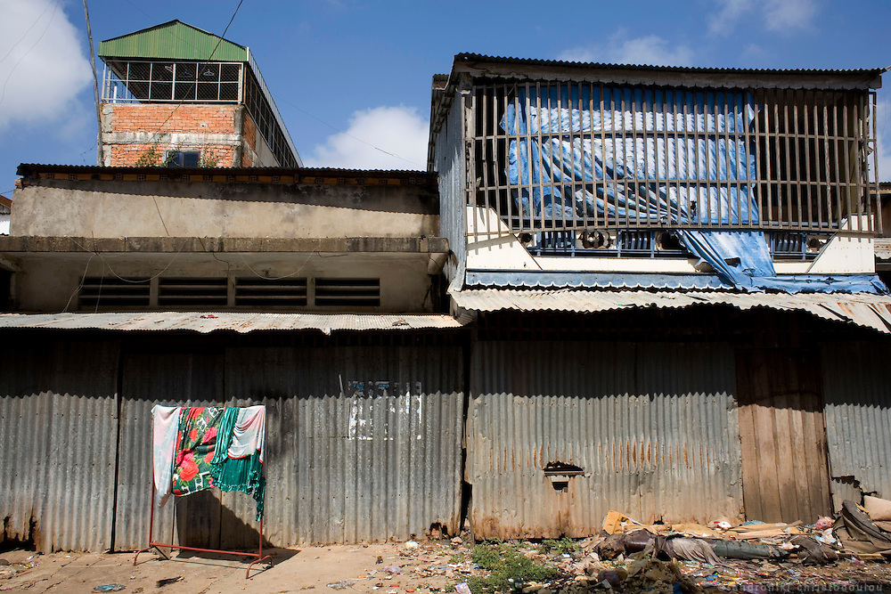 Building that used to be a brothel in Sway Pa village. Sway Pa is a Vietnamese village 11 Km away from Phnom Penh that used to openly be a center of sex trafficking, especialy of underaged girls, even children. One year ago the police cracked down on the brothels but NGO people and journalists who recently visited undercover, found out that underaged girls are still be available on request. Rummors say that the place never stoped functioning but went undercover as many other similar places that the police tried to close down.
