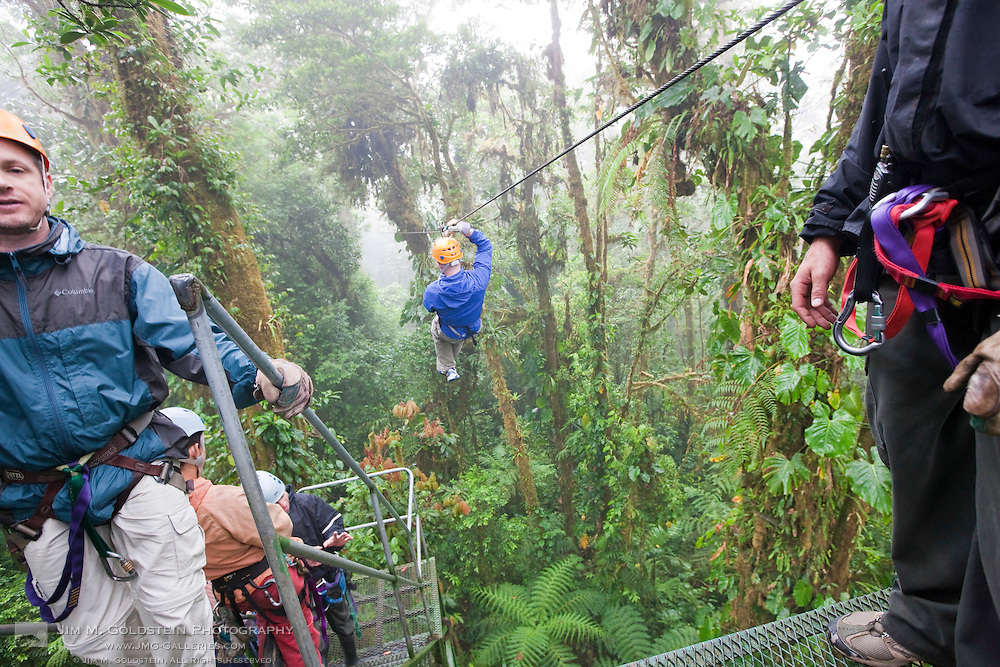 Zip lining through the rainforest canopy in the Monteverde Cloud Forest Reserve in Selvatura Adventure Park, Costa Rica