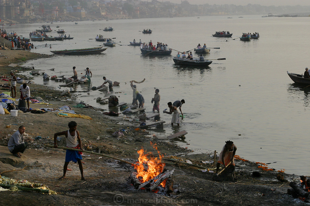 Death is part of the fabric of life for Hindus and like much of Indian society, takes place in open view. In the early morning men and women wash clothes in the river, slapping dhoti, saris, and other pieces of clothing against rocks and cement slabs as others tend to the bodies burning on the shore at Harishchandra Ghat.