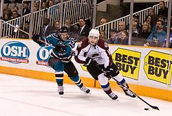 March 28, 2010; San Jose, CA, USA; Colorado Avalanche defenseman Kyle Cumiskey (10) skates past San Jose Sharks center Torrey Mitchell (17) during the second period at HP Pavilion. San Jose defeated Colorado 4-3. Mandatory Credit: Jason O. Watson / US PRESSWIRE