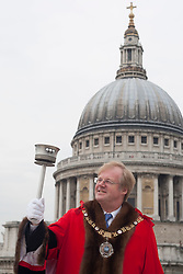 © licensed to London News Pictures. London, UK 18/05/2012. Lord Mayor of the City of London, David Wootton, holding the 1948 Olympic torch against the backdrop of St Paul?s Cathedral, to launch the Celebrate the City cultural celebration, this morning (18/05/12). Photo credit: Tolga Akmen/LNP