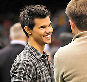 Twilight ACTOR TAYLOR LAUTNER hangs out on the Saints sidelines and poses with Saints owner Rita Benson Leblanc  prior to the kick off against the St. Louis Ram.The New Orleans Saints play the St. Louis rams in New Orleans at the Super Dome Sunday Dec. 12,2010. Saints went on to win 31-13. Photo©SuziAltman. New Orleans, Louisiana, U.S. - Twilight Actor TAYLOR LAUTNER hangs out on the Saints sidelines prior to the kick off against the St. Louis Ram.The New Orleans Saints play the St. Louis rams in New Orleans at the Super Dome Sunday Dec. 12,2010. Saints went on to win 31-13..(Credit Image: © Suzi Singer and actress MILEY CYRUS poses for a fan's camera phone with New Orleans police officers on the sidelines prior to The New Orleans Saints' kickoff against the St. Louis Rams at the Superdome. Cyrus is currently filming ''So Undercover'' in New Orleans.Photo©Suzi Altman Twilight series ACTOR TAYLOR LAUTNER  wears a headset and listens as the plays are being called on the New Orleans Sainst sidelines during the game against the St. Louis Rams. LAUTNER and poses with Saints owner Rita Benson Leblanc  prior to the kick off against the St. Louis Ram.The New Orleans Saints play the St. Louis rams in New Orleans at the Super Dome Sunday Dec. 12,2010. Saints won 31-13.Photo©SuziAltman. New Orleans, Louisiana, U.S. - Twilight Actor TAYLOR LAUTNER hangs out on the Saints sidelines prior to the kick off against the St. Louis Ram.The New Orleans Saints play the St. Louis rams in New Orleans at the Super Dome Sunday Dec. 12,2010. Saints went on to win 31-13..(Credit Image: © Suzi Singer and actress MILEY CYRUS poses for a fan's camera phone with New Orleans police officers on the sidelines prior to The New Orleans Saints' kickoff against the St. Louis Rams at the Superdome. Cyrus is currently filming ''So Undercover'' in New Orleans.Photo©Suzi Altman