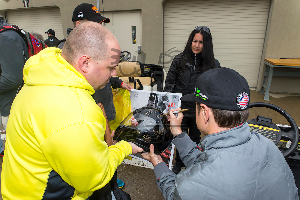 indianapolis, IN - May 16, 2014:  Kurt Busch (26) signs autographs for fans before a practice session for the Indianapolis 500 at Indianapolis Motor Speedway in indianapolis, IN.<br /> <br /> MANDATORY PHOTO CREDIT: Walter G. Arce, Sr. KBI Motorsports/ASPInc