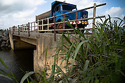 Truck crossing a bridge outside Lome, Togo on Thursday October 2, 2008.