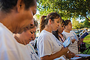 21 JUNE 2012 - PHOENIX, AZ: People pray in front of the Arizona State Capitol Thursday. About 40 people, members of the immigrant rights' group Promise AZ (PAZ), gathered at the Capitol in Phoenix to wait for the US Supreme Court decision on SB 1070, Arizona's controversial anti-immigrant law, in the case US v. Arizona. The court's ruling is expected sometime later this month. Members of PAZ said they would continue their vigil until the ruling was issued.         PHOTO BY JACK KURTZ