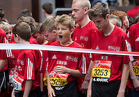 Competitors wait at the start of the U13 boys race. The Virgin Money London Marathon, Sunday 26th April 2015.<br /> <br /> Photo: Jed Leicester for Virgin Money London Marathon<br /> <br /> For more information please contact Penny Dain at pennyd@london-marathon.co.uk