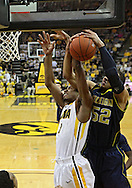February 19 2011: Iowa Hawkeyes forward Melsahn Basabe (1) and Michigan Wolverines forward Jordan Morgan (52) battle for a rebound during the first half of an NCAA college basketball game at Carver-Hawkeye Arena in Iowa City, Iowa on February 19, 2011. Michigan defeated Iowa 75-72 in overtime.