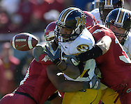 January 1, 2008 - Dallas, TX...Running back Tony Temple #22 of the Missouri Tigers fumbles the ball after getting hit by linebacker Weston Dacus #30 of the Arkansas Razorbacks in the third quarter, during the 72nd AT&T Cotton Bowl Classic at the Cotton Bowl in Dallas, Texas on January 1, 2008...The Tigers defeated the Razorbacks 38-7.  .Peter G. Aiken/CSM.