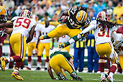 GREEN BAY, WI - SEPTEMBER 15:  Eddie Lacy #27 of the Green Bay Packers jumps over a this own man and is injured on the play against the Washington Redskins at Lambeau Field on September 15, 2013 in Green Bay, Wisconsin. (Photo by Wesley Hitt/Getty Images) *** Local Caption *** Eddie Lacy