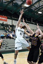 12 December 2015:  Rebekah Ehresman shoots over Allie Miceli during an NCAA women's basketball game between the Wisconsin Stevens Point Pointers and the Illinois Wesleyan Titans in Shirk Center, Bloomington IL