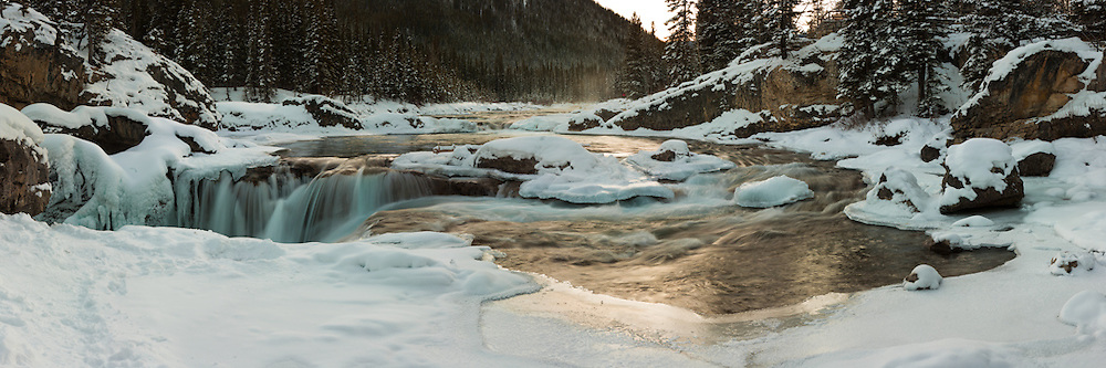 This is a a multi-image stitched panorama of Elbow Falls viewed from the top of the falls.