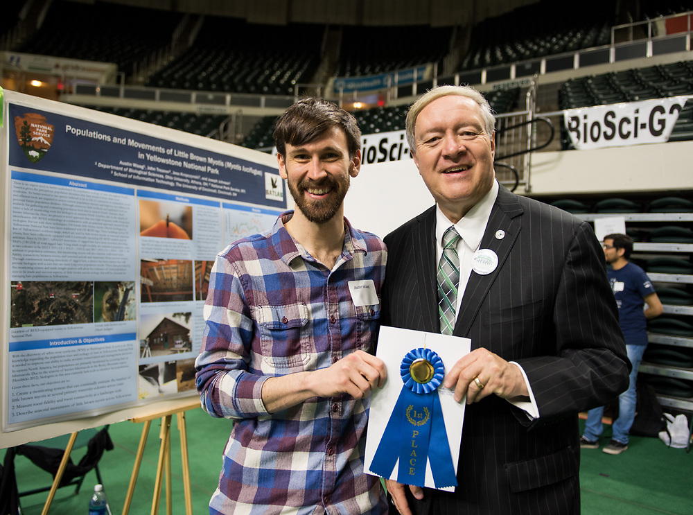 poses for a picture with Ohio University President Duane Nellis during the 2018 Student Research Expo.