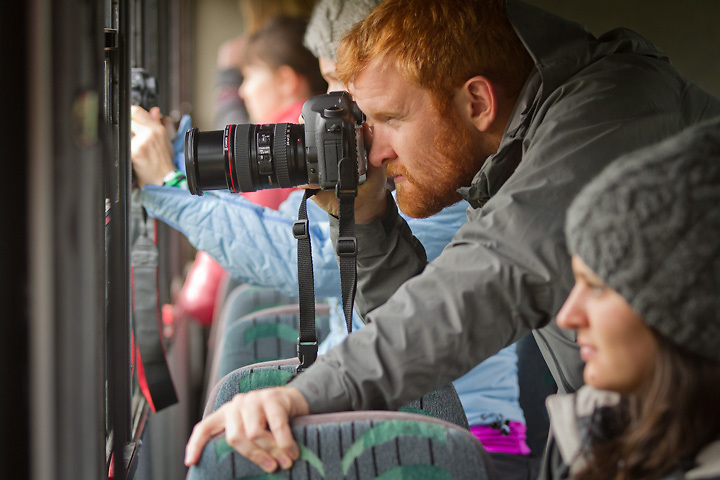 Graham Thatcher photographs wildlife from the Denali Park bus during a photo shoot for Royal Caribbean and Celebrity Cruises Alaska Excursions.