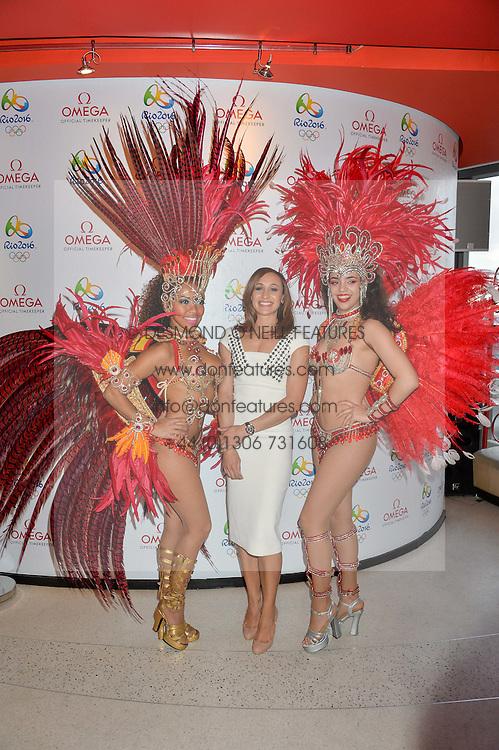 JESSICA ENNIS-HILL and samba dancer at the OMEGA 100 days to Rio Olympics VIP Dinner at Sushi Samba, Heron Tower, 110 Bishopsgate, City of London on 27th April 2016.