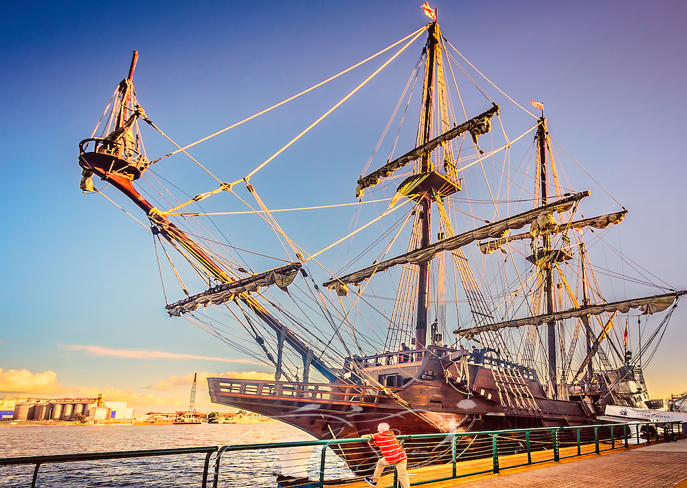 A young boy looks at El Galeón Andalucia, November 27, 2015, in Mobile, Alabama. The 170-foot long tall ship, is a replica of a 16th century Spanish galleon. Its home port is in St. Augustine, Florida, which was founded by Spain in 1565. (Photo by Carmen K. Sisson/Cloudybright)