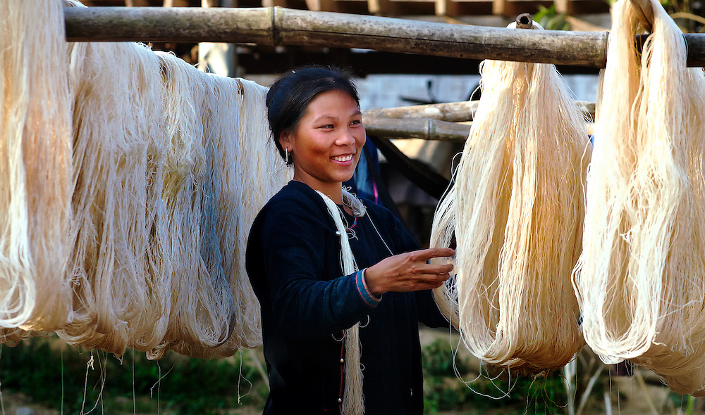 A Lanten girl checking the spun cotten in Luang Namtha, Laos.