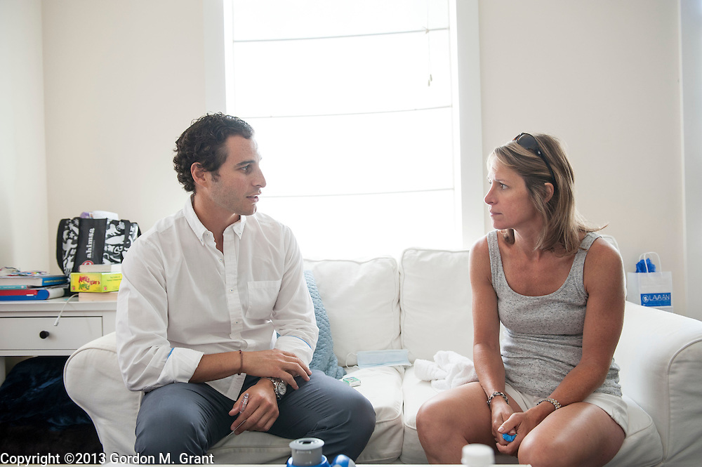 East Hampton, NY - 7/27/13 - Dr. Jeffrey Rappaport speaks with patient Kathryn Alisbah after whitening her teeth at her home in East Hampton, NY July 27, 2013. CREDIT: Gordon M. Grant for The Wall Street Journal<br /> NYTEETH