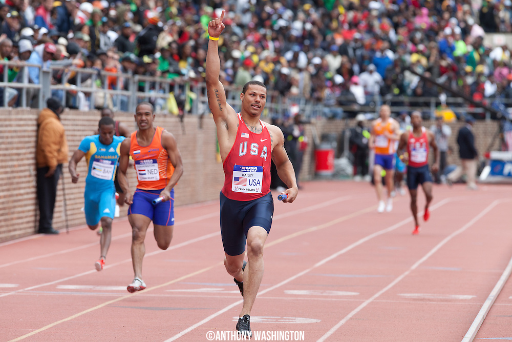 Ryan Bailey with the USA Red team, celebrates after crossing the finish line first following the USA vs. the World 4x100 heat during the Penn Relays athletics meet Saturday, April 28, 2012 in Philadelphia, PA.