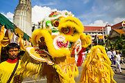01 OCTOBER 2014 - BANGKOK, THAILAND:  A Lion Dancer performs at Wat Yannawa (also spelled Yan Nawa) during the Vegetarian Festival in Bangkok. The Vegetarian Festival is celebrated throughout Thailand. It is the Thai version of the The Nine Emperor Gods Festival, a nine-day Taoist celebration beginning on the eve of 9th lunar month of the Chinese calendar. During a period of nine days, those who are participating in the festival dress all in white and abstain from eating meat, poultry, seafood, and dairy products. Vendors and proprietors of restaurants indicate that vegetarian food is for sale by putting a yellow flag out with Thai characters for meatless written on it in red.    PHOTO BY JACK KURTZ