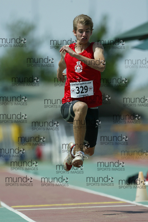 (Sherbrooke, Quebec -- 9 Aug 2009)  Mitch O'Donnell of Ontario competes in triple jump at the 2009 Legion Youth National Track and Field Championships. Photograph copyright Sean Burges / Mundo Sport Images  2009.