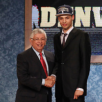 28 June 2012: French player Evan Fournier, picked up by the Denver Nuggets, poses with David Stern during the 2012 NBA Draft, at the Prudential Center, Newark, New Jersey.