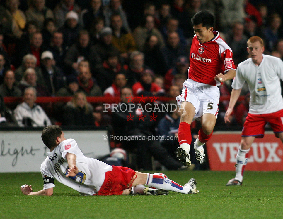 LONDON, ENGLAND - Friday, February 8, 2008: Charlton Athletic's Zheng Zhi in action against Crystal Palace's Mark Hudson during the League Championship match at the Valley. (Photo by Chris Ratcliffe/Propaganda)