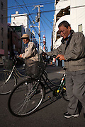Day laborers in the streets of Airin..The old name of the area now called Airin, was untill 1966 Kamagasaki and many people still call it like that. .Kamagasaki (????) is an old place name for a part of Nishinari-ku in Osaka, Japan. Airin-chiku (???????) became the region's official name in May, 1966.Sections of four different towns: Nishinari-ku Taishi (??????), Haginochaya (?????), Sanou (???), North Hanazono (????) and Tengachaya (?????) are collectively known as the Kamagasaki region..Kamagasaki as a place name existed until 1922. Kamagasaki is known as Japan's largest slum, and has the largest day laborer concentration in the entire country. 30,000 people are estimated to live in every 2,000 meter radius within this region. An accurate count of occupants has never been produced, even in the national census, due to the large population of day laborers who lack permanent addresses..