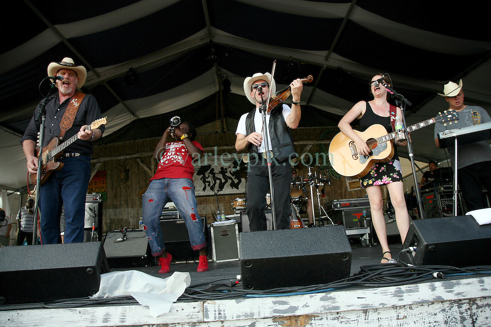 05 May 2012. New Orleans, Louisiana,  USA. .New Orleans Jazz and Heritage Festival. .L/R; Frontman Ray Benson, Shamarr Allen, fiddler Jason Roberts, Elizabeth McQueen and Eddie Rivers of the American country band 'Asleep at the Wheel,' winners of 9 Grammy awards..Photo; Charlie Varley.