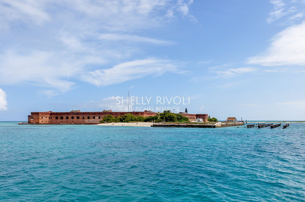 Island of Dry Tortugas with Fort Jefferson as seen from the Yankee Freedom ferry boat arriving from Key West, Florida. Daily service brings tourists from Key West.