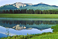 Reflections of 10,847 ft. Sand Mountain in Steamboat Lake, Steamboat Lake State Park, Colorado.  Photo was taken prior to the pine beetle infestation.
